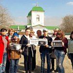 Жители села Синявское почтили память погибших во время пожара в торговом центре в Кемерове