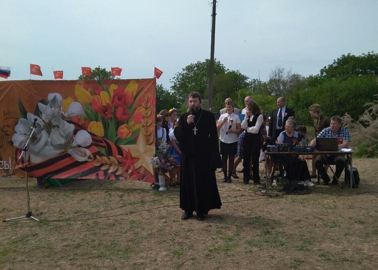 Настоятель Покровского прихода села Натальевка принял участие в торжественном митинге, посвященном Дню Победы